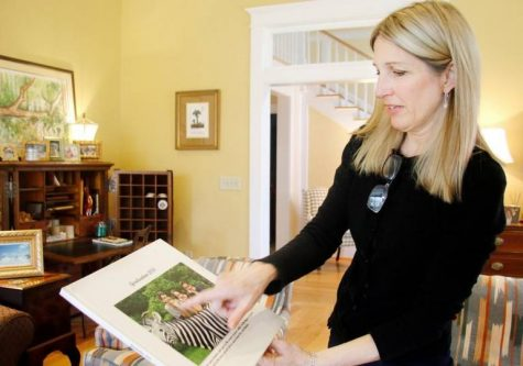 Ramona Sheridan looks at a picture of her daughter, Olivia Williams, who attended Central High School while her siblings attended Mount de Sales.