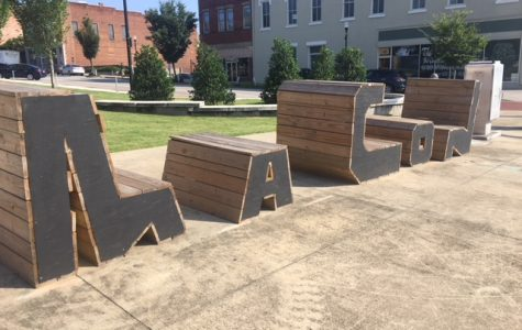 Benches spell out Macon on the corner of 2nd and Poplar street downtown.
