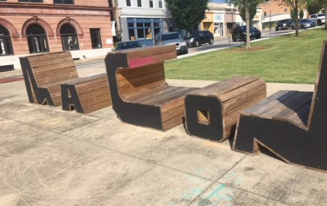 Benches spell out Macon downtown on the corners of 2nd and Poplar street. The benches are regularly moved around the city.