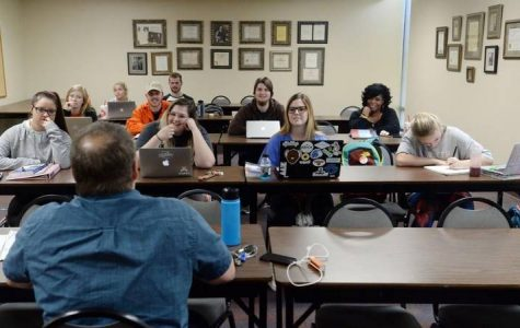 Vince Youngbaurer teaches a class for education majors at Mercer University.