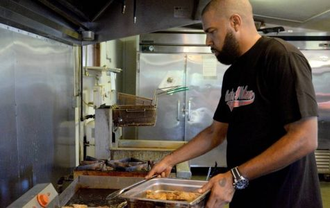 Maurice James, the owner of Kountry Kitchen & Seafood in Jeffersonville, prepares food for the upcoming lunch hour on Oct. 16. James said the restaurant has been open for four years.