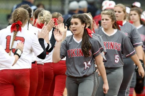 First Presbyterian Day School pitcher Karsen Ochs (10) high fives George Walton players with her teammates after their game Thursday in Columbus. FPD won 4-2 in nine innings.