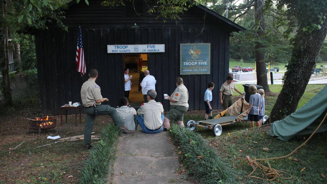 Robbie Thomas (far left) and a group of Eagle Scouts at a troop meeting in front of the Troop 5 Hut on September 18.