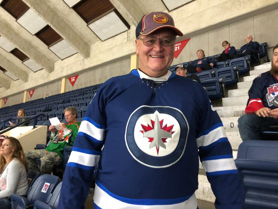 Richard+Roberts%2C+a+former+Atlanta+Thrashers+fan+turned+Winnipeg+Jets+fan%2C+supports+both+his+old+and+new+teams+as+he+takes+in+the+sights+and+sounds+of+the+game.+