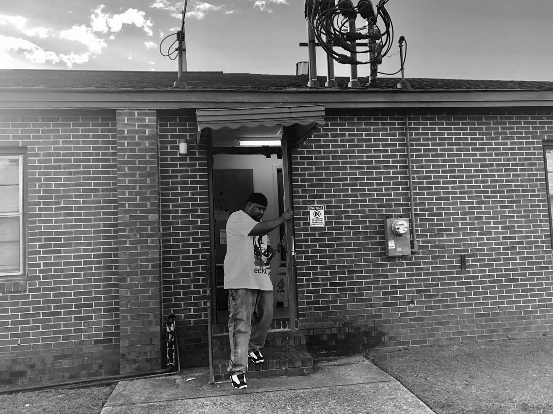 Embray Patterson steps out of his voting precinct at Glorious Hope Missionary Baptist Church on Napier Avenue in Macon.