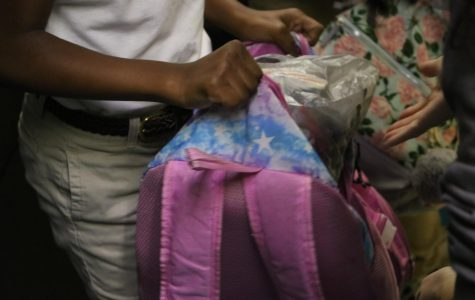 Backpack Ministry volunteer stops at a fourth-grade classroom to deliver a bag to Union Elementary Schoolstudent.