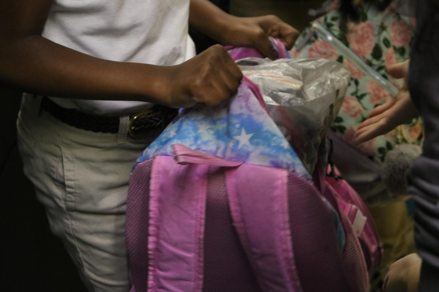 Backpack Ministry volunteer stops at a fourth-grade classroom to deliver a bag to Union Elementary School student.