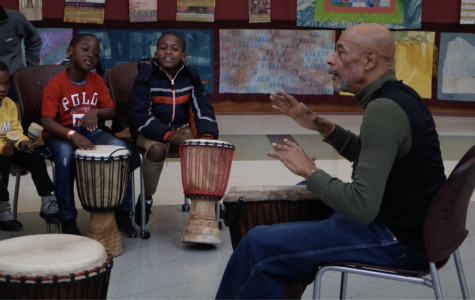 Brother Kwama teaching kids how to play the African drums at the Tubman Museum in February 2019.