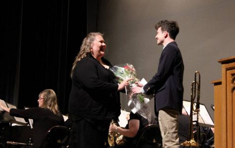 Lori Johnson receives flowers from a student after conducting at the Middle Georgia Concert Band's performance at Wesleyan College's Porter Auditorium on March 28, 2019.