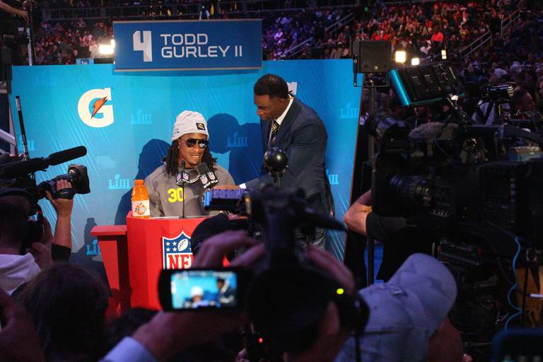Todd Gurley was swarmed by members of the media at Super Bowl Opening Night including Atlanta legend Deion Sanders.