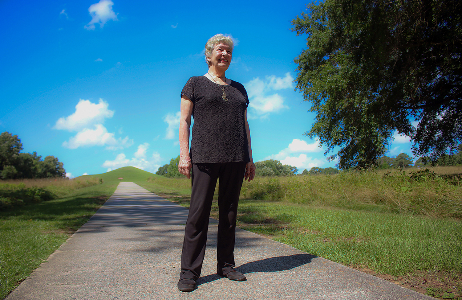 Sylvia Flowers stands proudly at the Ocmulgee National Park.