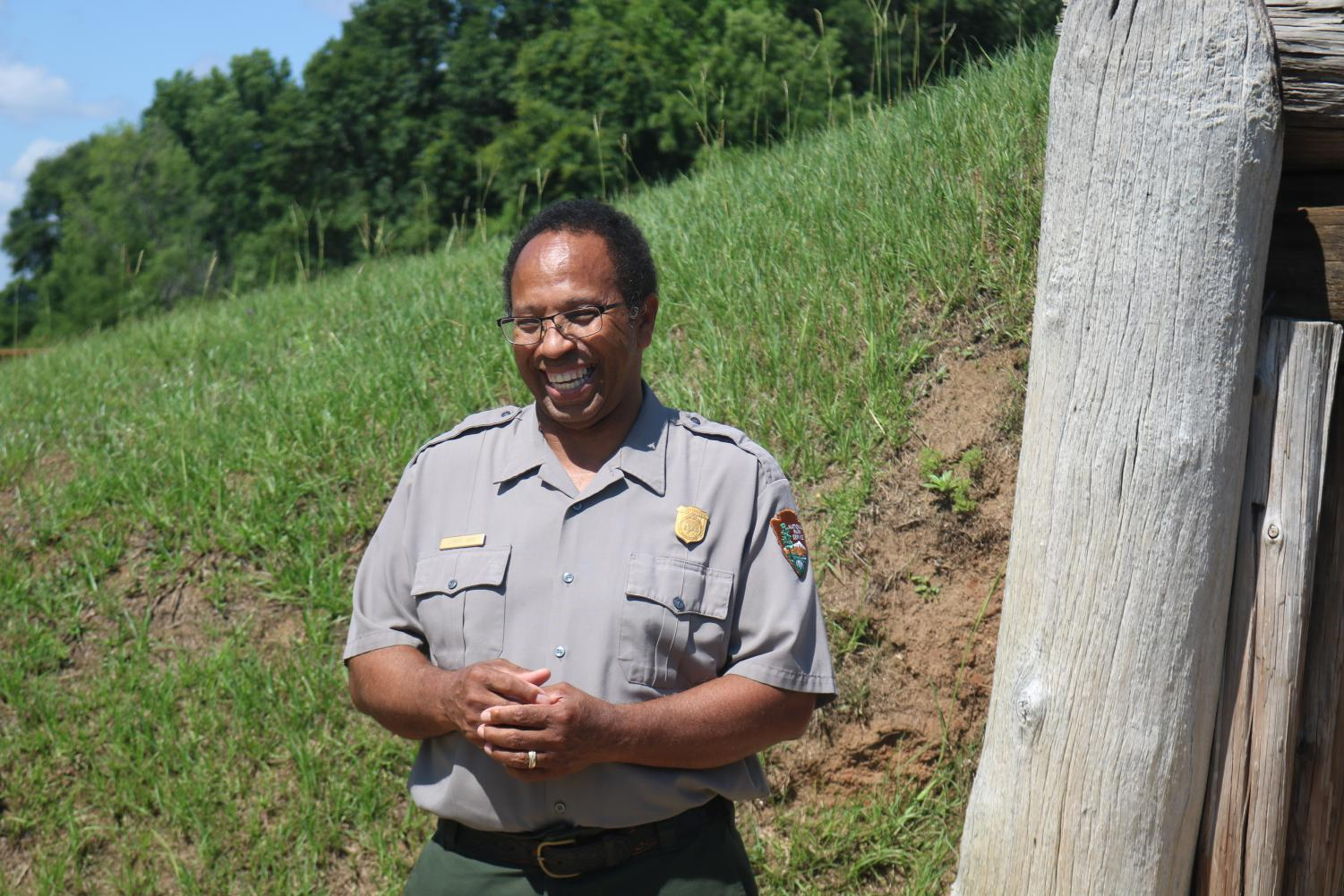 Davis stands outside one of the historical mounds.