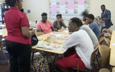Alicia Mays of UGA's Expanded Food and Nutrition Education Program, teaches Southwest High School boys healthy eating habits.