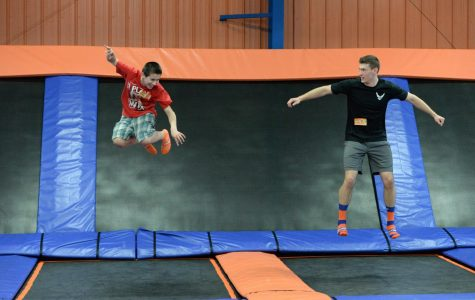 U.S. Air Force Senior Airman Sean Hummel, of the 119th Wing, right, jumps with his 'little wingman' Max during an outing at the Sky Zone indoor trampoline park, Fargo, North Dakota, April 16, 2015. Hummel has been mentoring Max for six years and is working on developing a youth mentoring program for members in the 119th Wing through the North Dakota Air National Guard Family Program called the Little Wingman Program. (U.S. Air National Guard photo by Senior Master Sgt. David H. Lipp/Released)