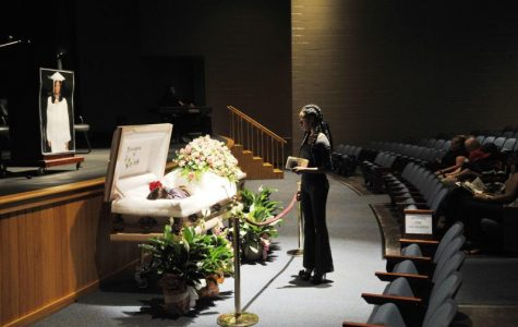Shaquavia Woodard pauses at the casket of her former classmate Shar'Bora Yan'Kita Shyrell Daniels before Daniels' funeral in the auditorium of Central High School in Macon in 2012.