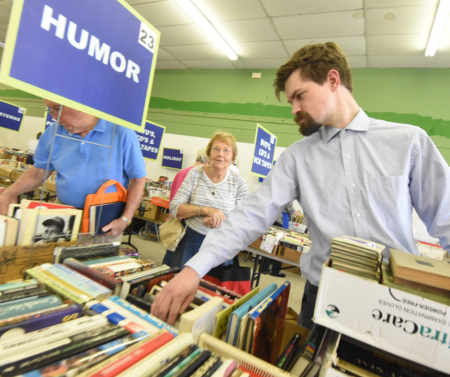 Customers browse the humor section at the Friends of the Library Macon book sale in 2018. Photo credit: Friends of the Library Macon
