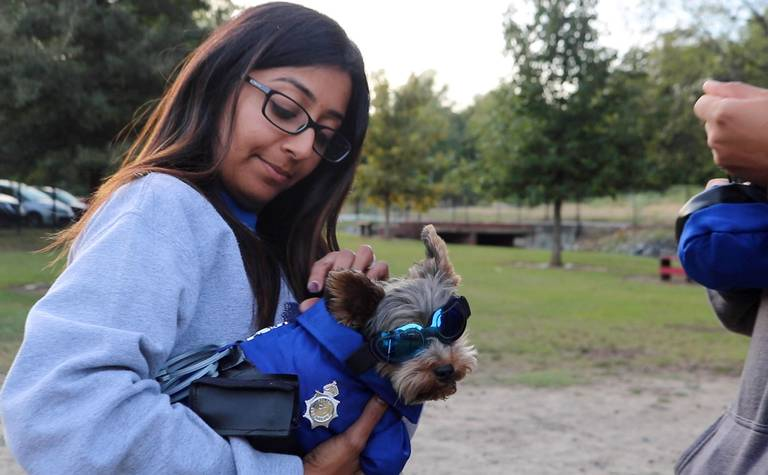 Heena+Patel+holds+her+dog+Paksh+at+Macon-Bibb+County+Parks+and+Recreation+Department%E2%80%99s+2019+Howl-O-Ween+at+the+Macon+Dog+Park+on+Thursday.+Photo+credit%3A+Ethan+Thompson