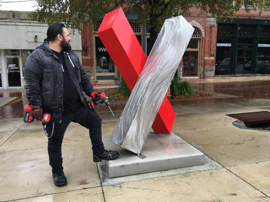 Artist+Alex+Mendez%2C+of+Decatur%2C+Indiana%2C+installed+his+sculpture%2C+%22X+marks+the+spot%2C%22+Friday+on+First+Street+in+Downtown+Macon.+