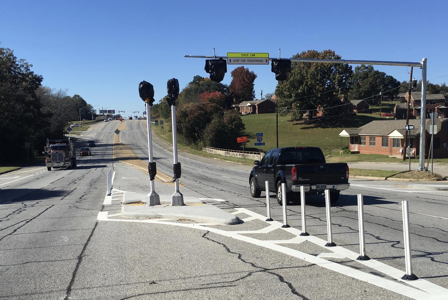 A new Pedestrian Hybrid Beacon system awaits activation after the Georgia Department of Transportation installed the safety equipment on Eisenhower Parkway at C Street where a child was hit trying to cross the street in 2010.