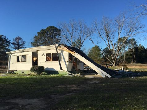 A south Bibb County home sits dismantled at the corner of Kearnes and McArrell drives where Georgia Power will begin building a 650 acre solar farm in 2020.