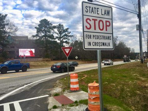 New pedestrian crossings lead to a drainage ditch on Bass Road at the Interstate 75 off-ramp.