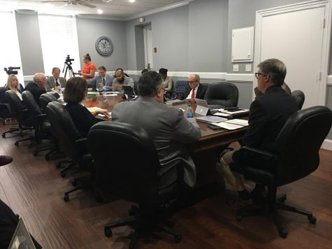 CPA Miller Edwards, right, briefs Macon-Bibb County leaders on the Fiscal 2019 audit that saw a $13.5 million dollar surplus.