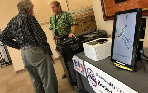 Macon-Bibb County elections officer Thomas Gillon demonstrates the new voting machines at the board of elections office on Pio Nono Avenue.