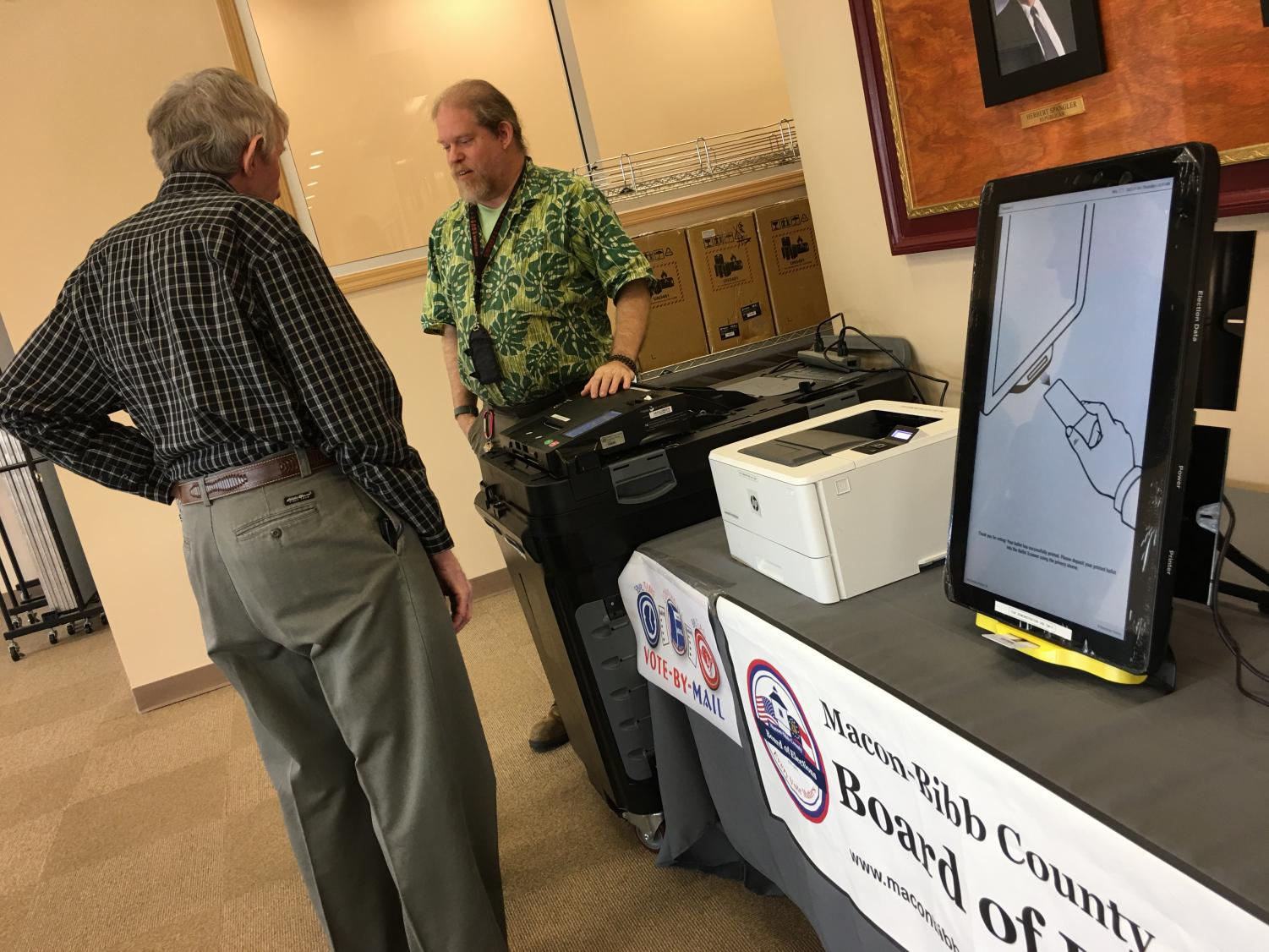 Macon-Bibb County elections officer Thomas Gillon demonstrates the new voting machines Thursday at the board of elections office on Pio Nono Avenue.