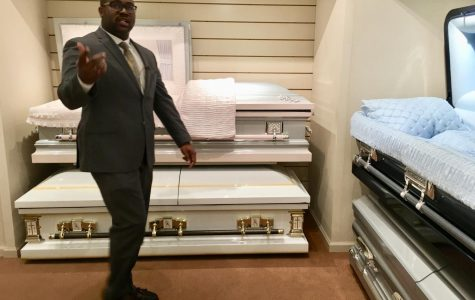 Funeral home owner Richard Robinson leads reporters through his casket showroom as an example of how he plans tours for young people in an effort to curb deadly violence in Macon.