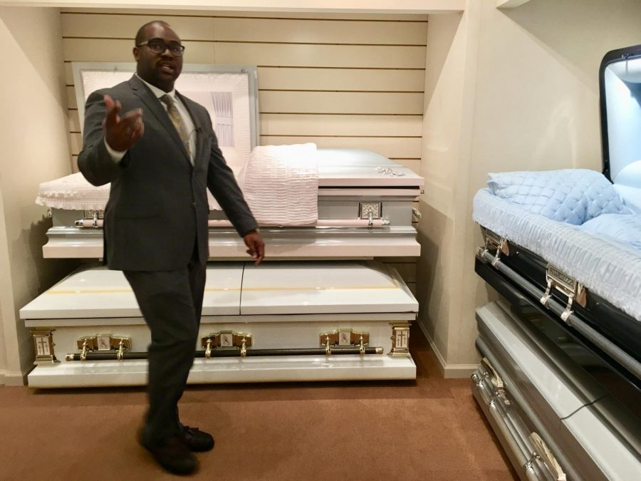 Funeral+home+owner+Richard+Robinson+leads+reporters+through+his+casket+showroom+as+an+example+of+how+he+plans+tours+for+young+people+in+an+effort+to+curb+deadly+violence+in+Macon.