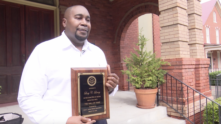 ichael Gray, the great, great, great nephew of Lucy Craft Laney, at Washington Avenue Presbyterian Church on Tuesday with a Hall of Fame plaque from Lucy Craft Laney High School in Augusta, Georgia, that was presented to the family in 2016.