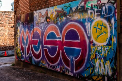 """Graffiti wall near the 567 Center. """"Thanks to generous donors who were also passionate about beautifying the alleyways and promoting art, we were able to install [the graffiti walls] around downtown"""" Macker said."""