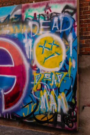 """Graffiti wall near the 567 Center. """"Users range from people casually writing messages on the walls to street artists who paint large murals on the walls"""" Macker said."""