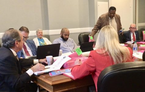 Mayor pro tem Al Tillman takes his seat at the start of Macon-Bibb Commission committee meetings Tuesday morning.