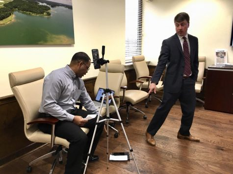 Macon-Bibb County Industrial Authority executive director Stephen Adams, right, motions to the authority's marketing manager Dan Hall who was setting up a Facebook live session for the March 18 meeting.