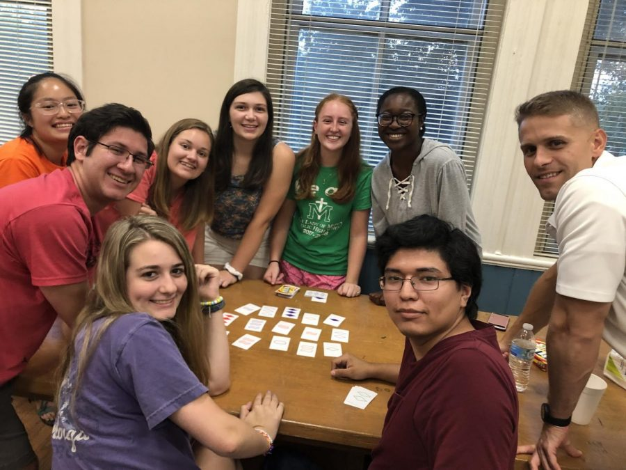 A+group+of+members+of+Mercer%E2%80%99s+Catholic+Campus+Ministry+enjoy+each+other%E2%80%99s+company+as+they+play+a+card+game+at+their+first+meeting+of+the+year+in+August+2019.