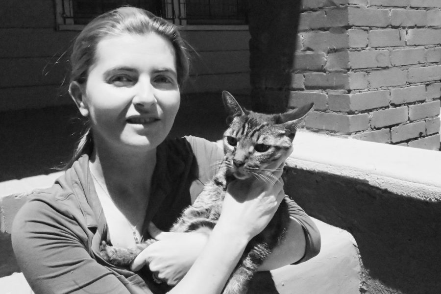 Rebecca is featured above with her cat, Chester.