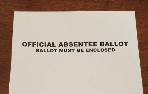 Absentee ballots mailed from Georgia's Secretary of State do not have a privacy envelope but contain a sheet of paper to be wrapped around the ballot before it is inserted in a yellow and white mailing envelope.