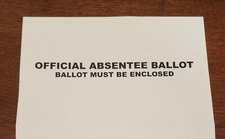 Absentee+ballots+mailed+from+Georgia%27s+Secretary+of+State+do+not+have+a+privacy+envelope+but+contain+a+sheet+of+paper+to+be+wrapped+around+the+ballot+before+it+is+inserted+in+a+yellow+and+white+mailing+envelope.+