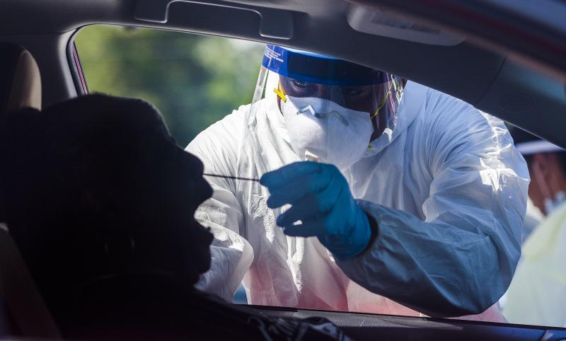 Testing performed by a private lab in a church parking lot in Macon. Testers usually recommend breathing through the mouth as the swab goes to the back of the nasal cavity.