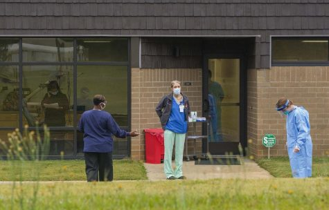 "Technicians at the Hancock County Health Department wait to perform a coronavirus test in May. The virus spread in Hancock has been labeled ""severe."""