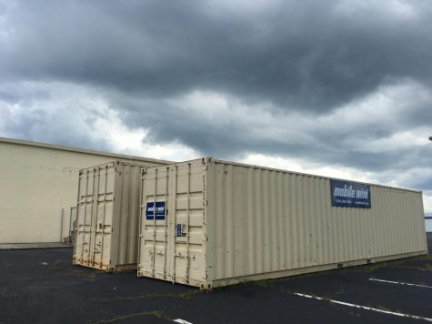 Two rented shipping containers behind the Macon-Bibb County Board of Elections represent just one of the added expenses for the state