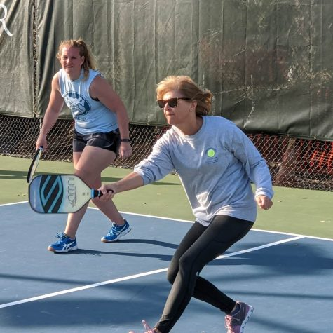 Two pickleball players play a match at Tatnall Tennis.