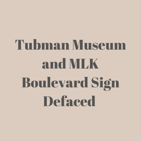 "the words ""Tubman Museum and MLK Boulevard Sign Defaced"" in black block letters."