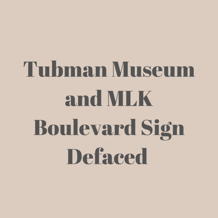 the+words+%22Tubman+Museum+and+MLK+Boulevard+Sign+Defaced%22+in+black+block+letters.