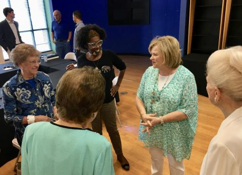Former Keep Macon Bibb Beautiful CEO Pam Carswell, second from right, speaks with board members at her retirement lunch in June.