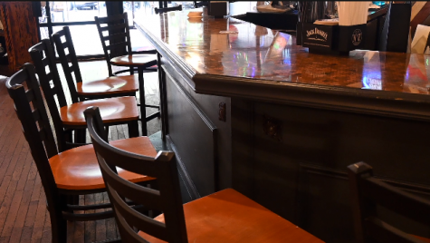 Once full barstools at Parish on 2nd are now empty, as restaurant owners hope more customers will return to dining rooms amid the pandemic.