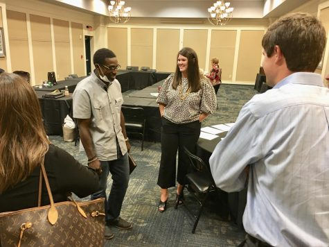 Caroline Childs, center, the new CEO of Keep Macon-Bibb Beautiful, chats with board members after her first meeting Wednesday.