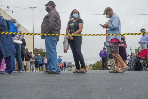 Voters wait in line at the Macon-Bibb County Board of Elections during early voting in the 2020 Presidential Election.