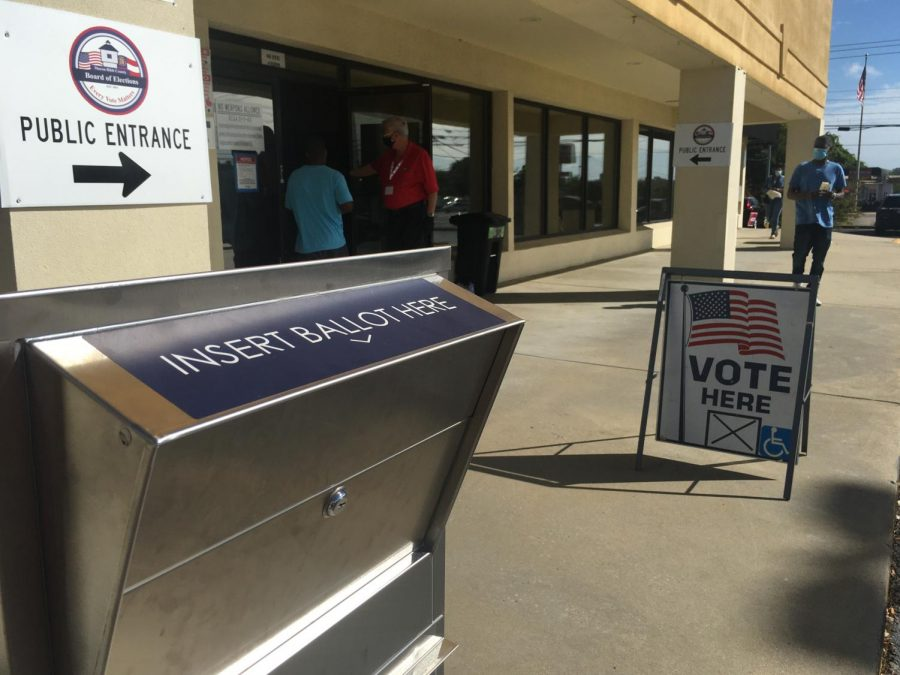 Early voters enter the Macon-Bibb County Board of Elections to cast ballots Friday in the 2020 Presidential Election.